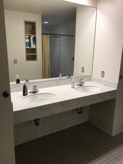 Two sinks between 4 people.